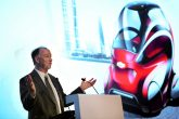 GM China Group President and Managing Director Kevin Wale shows an image of the Chevrolet EN-V 2.0 concept, the next version of its revolutionary mobility concept, in Beijing.