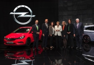 Chancellor Angela Merkel at the Opel booth