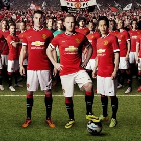 Robin van Persie, Wayne Rooney and Shinji Kagawa are shown wearing the 2014-2015 Manchester United shirt