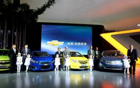 SAIC, General Motors and Shanghai General Motors executives with the Chevrolet Show Cars. (from left to right: Ding Lei, President and General Manager of Shanghai General Motors. Chen Hong, Vice Chairman and President of SAIC.  Hu Maoyuan, Chairman of SAIC, Tim Lee, President of GM International Operations. Kevin Wale, President and Managing Director of GM China group. Edward Welburn, GM Vice President, Global Design. Joseph Liu, Executive vice president, Shanghai General Motors.)