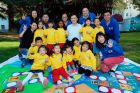 GM Executive Vice President and GM China President Matt Tsien plays an interactive game with children.