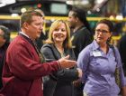 "General Motors CEO Mary Barra (center) tours the GM Fairfax Assembly plant with General Assembly Area Manager Troy Comiskey and UAW Local 31 President Vicki Hale Monday, May 4, 2015 before announcing that more than 500 million GM-branded vehicles have been built globally - the most of any automaker by far - during an event at the plant in Kansas City, Kansas. Putting customers at the center of this accomplishment, Barra and GM North America President Alan Batey surprised surprised Iraqi war veteran Trent Brining with a ""key"" to a 2016 Chevrolet Malibu. Production of the midsize sedan begins at the Fairfax plant later this year. (Photo by Steve Fecht for General Motors)"