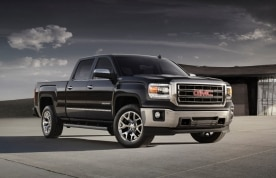 2014 GMC Sierra SLT Crew Cab Front Three Quarter in Iridium Metallic - on location